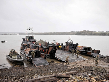 Landing craft lined up on Wilson's Beach during a training exercise