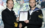 LChef Brown receives his commendation from the Chief of Joint Operations Rear Admiral David Steel