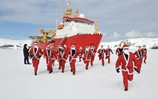 HMS Protector Takes To The Ice For A Charity Santa Run