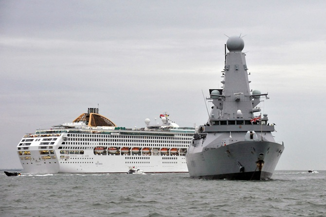 Dragon salutes historic sail past by cruise liners in the Solent murk