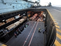 Carrier begins delivery of aid to remote Philippine Islands