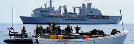 A Royal Marines boarding team embarked om RFA Fort Victoria capture a pirate skiff
