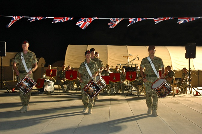 Cpl Tim Needham (far right) leads the Corps of Drums at the opening of the show