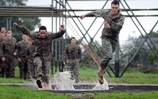 US Marine Tackle the Bottom Field at Commando Training Centre
