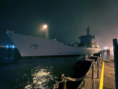 HMS Scott leaving Plymouth by night