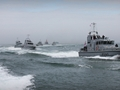 HMS Archer leads out other P2000s