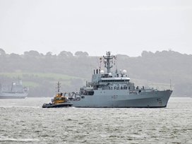 HMS Echo as she enters HMNB Devonport's Dockyard on return from her deployment