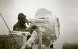 One of the signalling lamps aboard cruiser HMS Sheffield is covered in ice during a convoy to Russia in December 1941