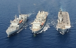 Three ships hold replenishment at sea