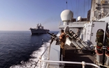 HMS Illustrious sails through the strait of Hormuz