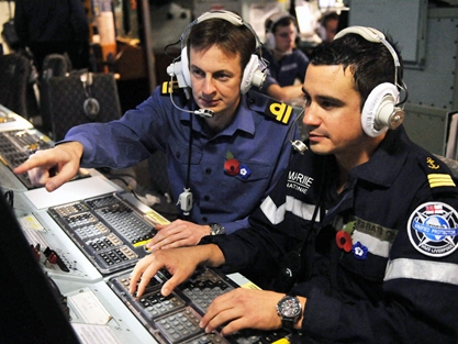 French and UK Officers in the Operations Room of HMS Illustrious