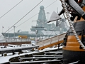 Old and new together in the snow: HMS Victory and HMS Diamond