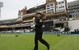 Royal Navy Sailor carries cricket trophy