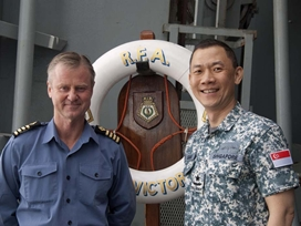 Capt Kevin Rimell RFA welcomes RAdm Giam Hock Koon RSN aboard RFA Fort Victoria