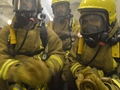 The Ships Company of HMS Diamond undertake firefighting drills