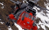 A Gannet Sea King conducts training in the snowy Highlands