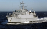 Blyth prepares to sail past Turkish minehunter TCG Ayvalik as part of a manoeuvring exercise
