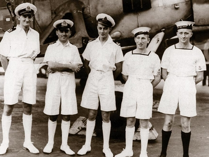 Lt Cdr Eugene Esmonde (second from left) and comrades stand in the shadow of a Swordfish torpedo bomber (Picture Fleet Air Arm Museum)