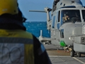Royal Navy Lynx helicopters train on warship