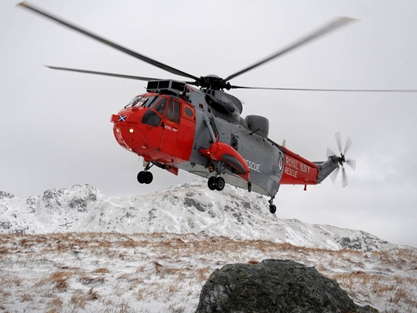 HMS Gannet's' Sea King in the snowy west of Scotland mountains