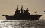 HMS Illustrious flies the flag proudly as she prepared for a busy 2013
