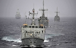 HMS Shoreham leads American minehunters USS Dextrous and Sentry through the Strait of Hormuz with HMS Diamond providing escort. Picture: PO(MTO) Chris Weissenborn, RNZN