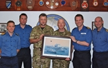 COs of UK MCM Force present Commodore Allen (USN) with commemorative painting